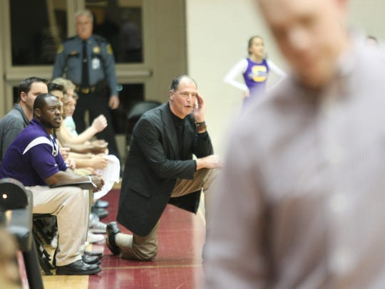 Clarksville HIgh coach Ted Young (kneeling) shouts