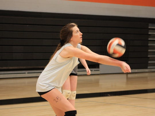 Sophomore Emma Key passes the ball during the June