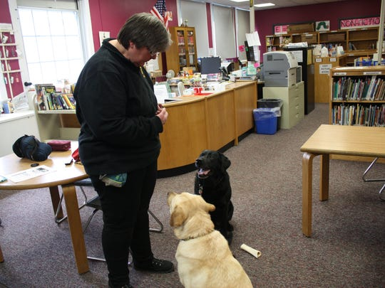 Rhonda Ashley, a Curriculum Instructor/AIS Service Provider at Palmer Elementary School, brings her two dogs into Palmer Elementary School to work as therapy dogs.