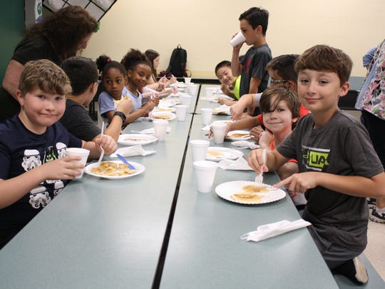 Students at Vestal Hills Elementary School enjoyed pancakes made by their teachers Wednesday morning.