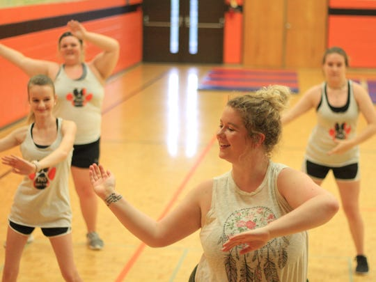 PHS Dance Team Coach Skylar Terry smiles as she sways