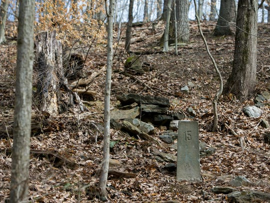 A concrete marker denotes the border between Delaware and Pennsylvania in Beaver Valley, which is part of the First State National Historic Park.
