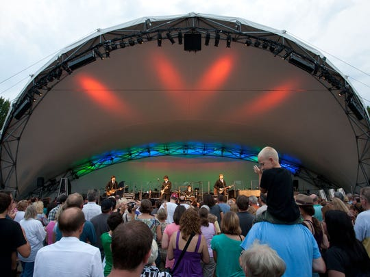 """Concertgoers dance near the stage at Conner Prairie in Fishers during the """"Classical Mystery Tour — Music of the Beatle,"""" a Symphony on the Prairie event, on Aug. 13, 2011."""