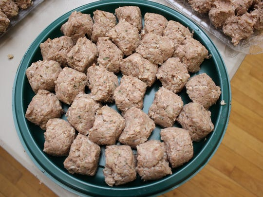 Ground beef is seasoned and rolled into balls before