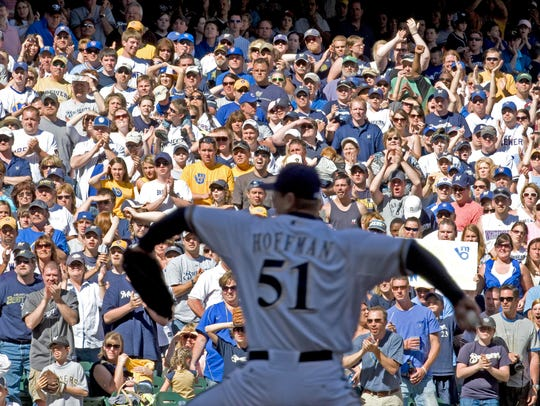 Milwaukee Brewers fans cheers as relief pitcher Trevor