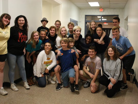 "Members of the evening cast of the Summer Youth Musical Theater Workshop production of ""Sweeney Todd"" pose during a rehearsal on July 25."