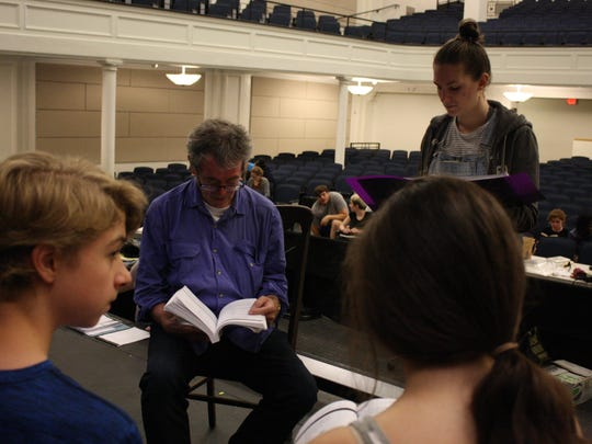 "Jim Lortz (center), the director of the Summer Youth Musical Theater Workshop's production of ""Sweeney Todd,"" instructs members of the evening cast."