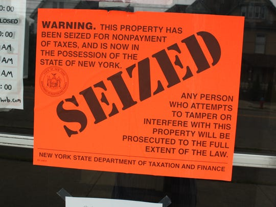 Signs posted outside of Grottaa Azzura in Binghamton