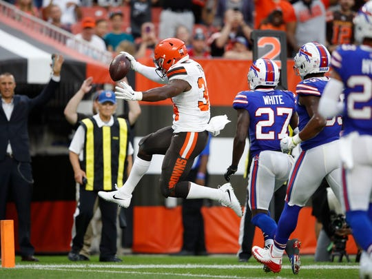CLEVELAND, OH - AUGUST 17: Carlos Hyde #34 of the Cleveland Browns runs for a four-yard touchdown in the first quarter of a preseason game against the Buffalo Bills at FirstEnergy Stadium on August 17, 2018 in Cleveland, Ohio. (Photo by Joe Robbins/Getty Images)