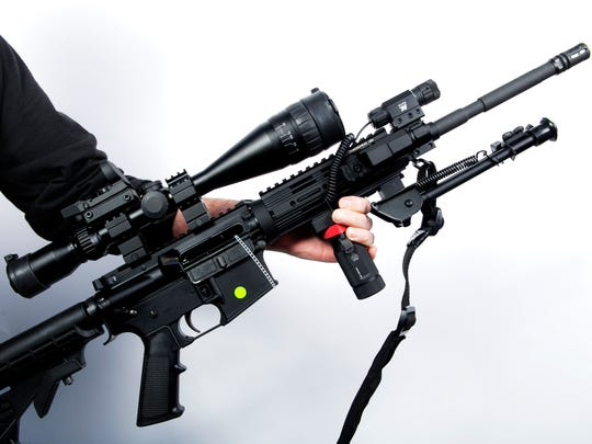 An AR-15 rifle is displayed at the Crossroads of the