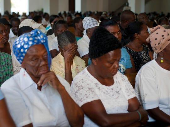 Haitians attend a Mass marking the 5th anniversary