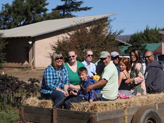 Visitors prepare for a hay ride tour of the ALBA ranch