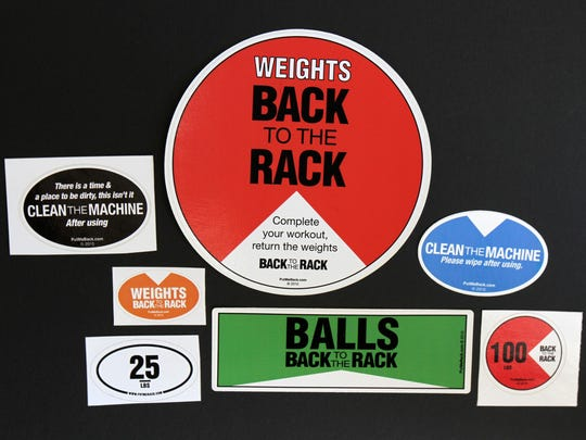 Some of the stickers sold by Put Me Back LLC, a Toms River business that helps organize weights, dumbbells and other equipment at gyms.