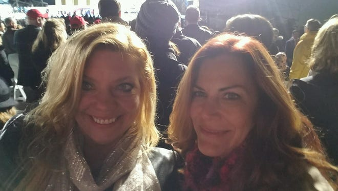 Wicomico County Republican Central Committee member Julie Brewington, left, attends the inaugural concert in Washington, D.C., on Thursday, Jan. 19.