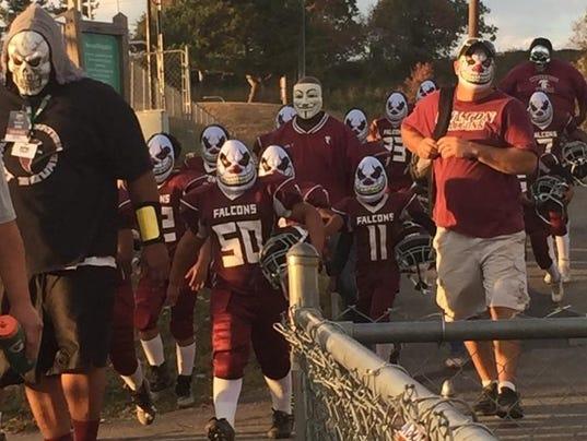 Fulton Falcons in clown masks