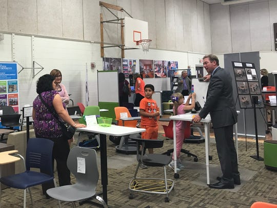 A vendor explains his products to parents and students at an EPISD furniture expo at Burges High School on Wednesday.