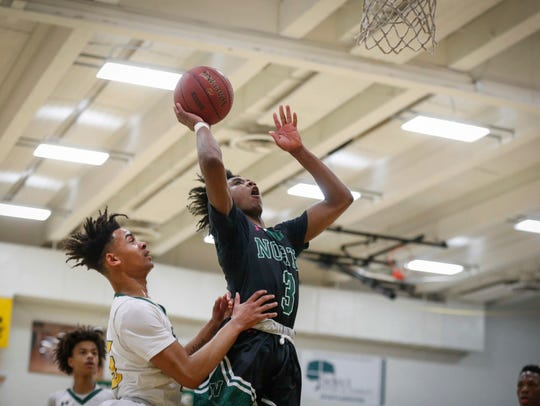 Des Moines North junior point guard Tyreke Locure runs