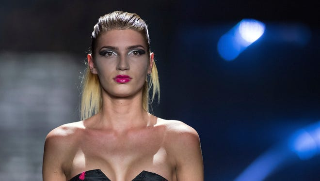 Model Giuliana, who became well known with the show 'Germany's Next Topmodel,' appears during a fashion show in Berlin. Germany's edition of Playboy magazine said it will be featuring the transgender model on its cover for the first time ever this month.