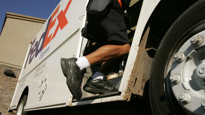 A file photo of a FedEx delivery truck in Mesa.