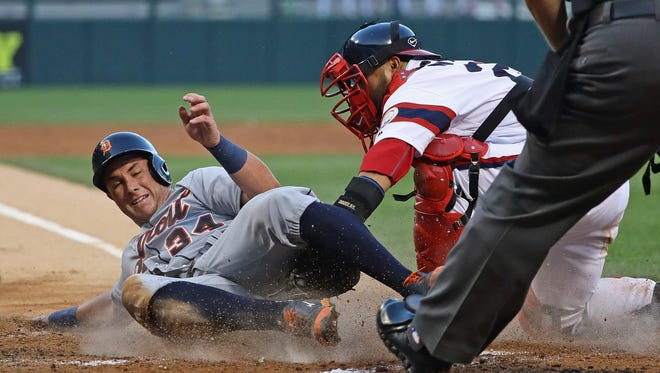 540481156.jpg CHICAGO, IL - JUNE 15: James McCann #34 of the Detroit Tigers is tagged out at the plate by Dioner Navarro #27 of the Chicago White Sox in the 3rd inning at U.S. Cellular Field on June 15, 2016 in Chicago, Illinois. (Photo by Jonathan Daniel/Getty Images)