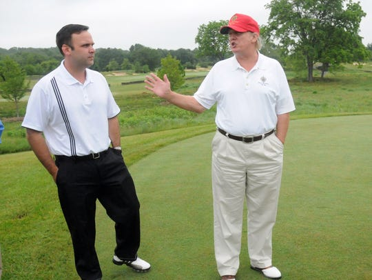 Donald Trump, right, speaks with Dan Scavino, during