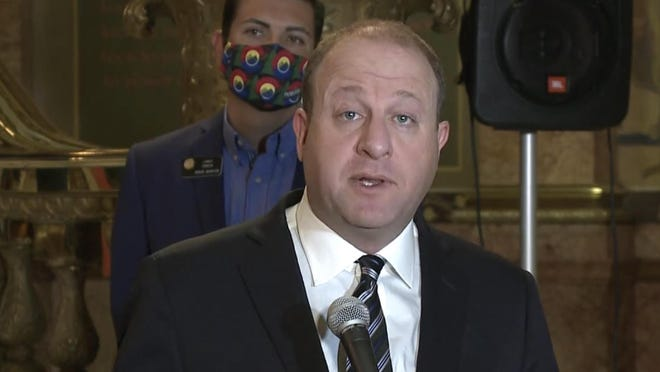 Colorado Gov. Jared Polis spoke before signing police accountability legislation Friday. State Senate President Leroy Garcia looks on.