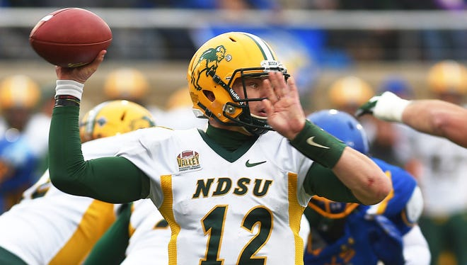 North Dakota State University's Easton Stick looks for an open player during the game against South Dakota State University Saturday, Nov. 4, at Dana Dykhouse Stadium in Brookings.
