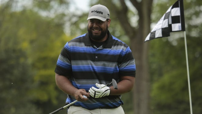 Detroit Lions guard Larry Warford reacts after missing a putt during the Charlie Sanders Foundation Golf Outing at Knollwood Country Club in West Bloomfield on Monday June 1, 2015.