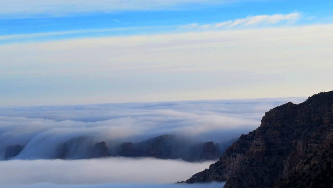 Dense clouds at the South Rim of the Grand Canyon on Thursday, Dec. 11, 2014. A rare weather phenomenon on Thursday had visitors looking out to a sea of thick clouds.