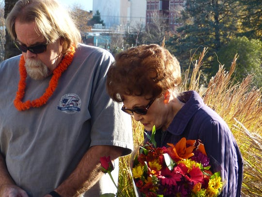 Mike Woodrum, the son of a Pearl Harbor survivor, prays