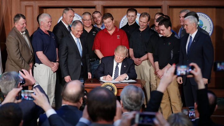 President Trump, accompanied by Environmental Protection