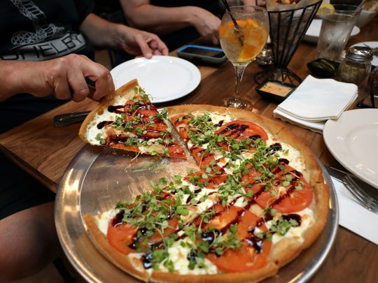 """The Margherita """"It's Five O'clock Somewhere"""" pizza at the Nanuet Restaurant on Main Street in Nanuet, May 29, 2018."""