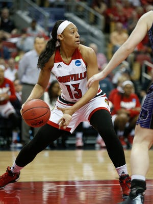Louisville's Cortnee Walton grabbed arebound and looked for a teammate to pass to. March 18, 2016