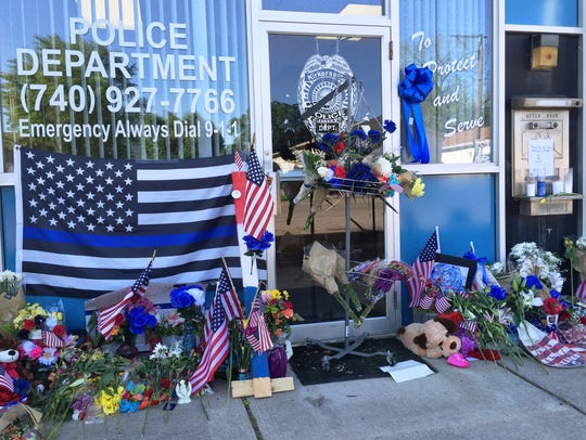 Dozens of flowers, flags and other items were part