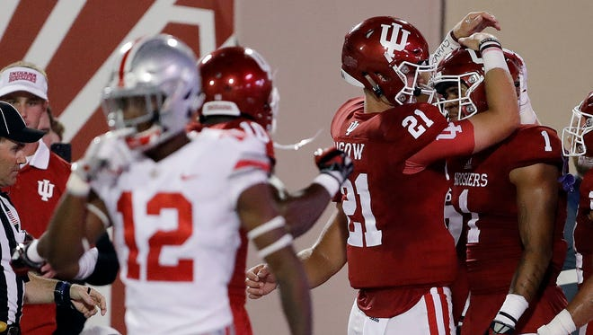 Indiana quarterback Richard Lagow (21) celebrates an 8-yard touchdown reception by wide receiver Simmie Cobbs Jr. (1) against Ohio State, Sept. 1, 2017/