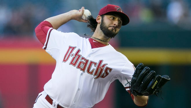 Diamondbacks' Mike Bolsinger pitches in the first inning against the Brewers at Chase Field in Phoenix, AZ on Tuesday, June 17, 2014.