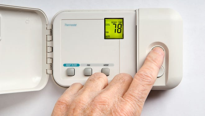 Setting wall thermostat to 78 degrees Fahrenheit as a conservation measure in summer.