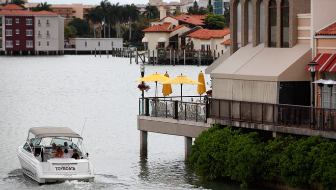 A busing station at MiraMare Ristorante in the Village Shops on Venetian Bay.