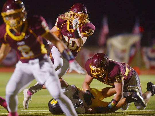 Harrisburg's Jack Anderson runs the ball during the game against Mitchell Friday, Oct. 13, in Harrisburg.