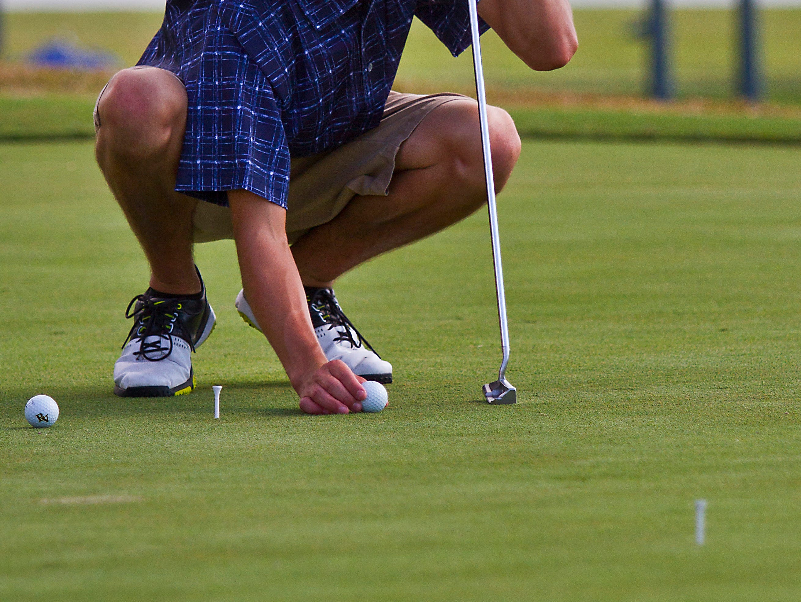 Bishop Verot High School freshman Blake Wheeler, 15, of Fort Myers, works on a putting drill Thursday afternoon at Stoneybrook Golf Club during a team practice.