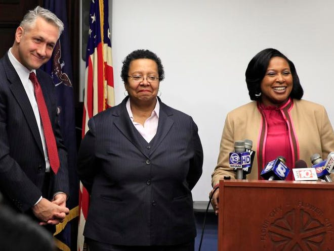 Mayor-elect Lovely Warren, right, introduced the lead members of her transition team at City Hall on Wednesday morning. They are lawyer Christopher Thomas, a partner at Nixon, Peabody, left, and dt ogilvie, dean and professor of business strategy at the Saunders College of Business at the Rochester Institute of Technology.