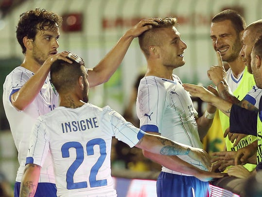 Italy forward Ciro Immobile, third from left, celebrates with his teammates after scoring during a World Cup warm up soccer match between Italy and Fluminense at the Cidadania stadium, in Volta Redonda, Brazil, Sunday, June 8, 2014. Italy plays in group D of the 2014 soccer World Cup. (AP Photo/Antonio Calanni)