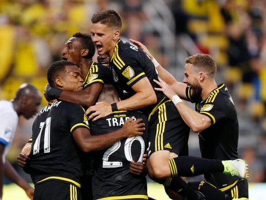 Columbus Crew players celebrate a goal against the Montreal Impact during the second half of an MLS soccer match Saturday, June 24, 2017, in Columbus, Ohio. The Crew won 4-1. (AP Photo/Jay LaPrete)