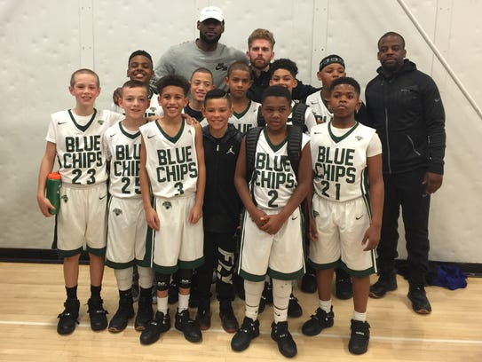 LeBron James with members of the North Coast Blue Chips