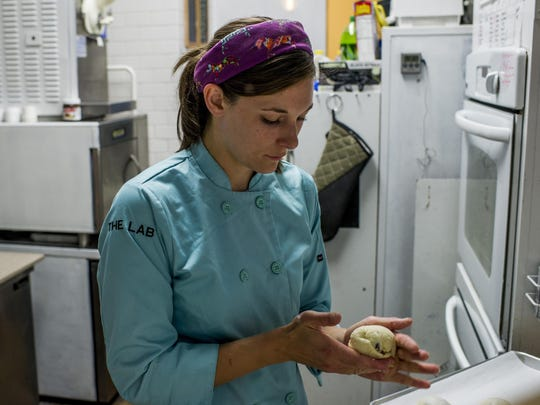 Pastry chef Lindsey Sterling rolls a pastry into a