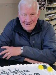 Dale Fridley receives cake for 45th anniversary at