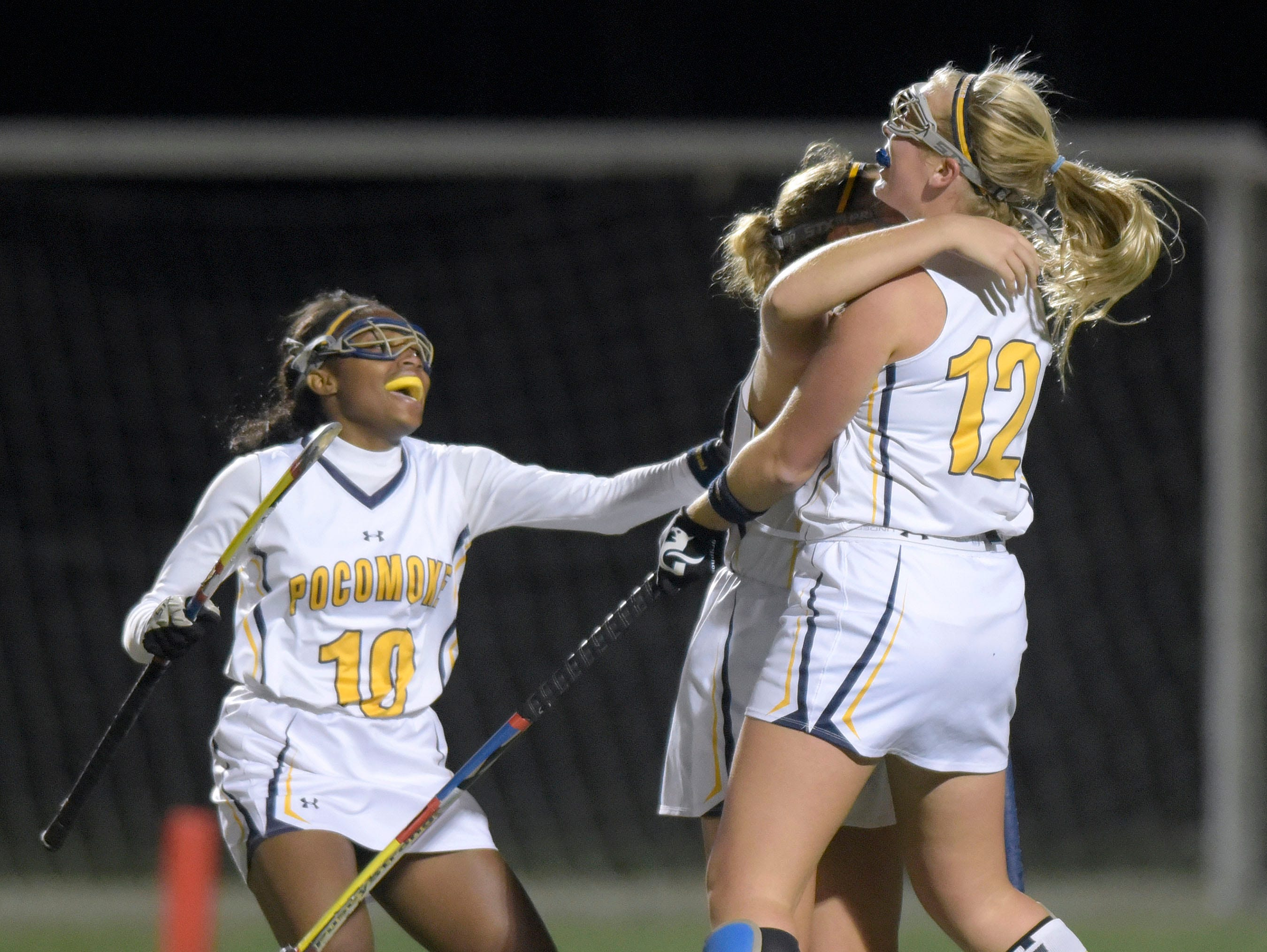 From left, Pocomoke's Shayla Jones, Kasey Lee and Lexi Butler celebrate Lee's goal against Manchester Valley in the second half of a Class 1A state semifinal field hockey game, Wednesday, Nov. 11, 2015 in Burtonsville.