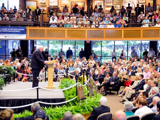 Tom Durkin, Master of Ceremonies speaks during the National Museum of Racing's Hall of Fame induction ceremony at the Fasig-Tipton Humphrey S. Finney Pavilion in Saratoga Springs, N.Y., Friday Aug. 9, 2013. (AP Photo/Hans Pennink)