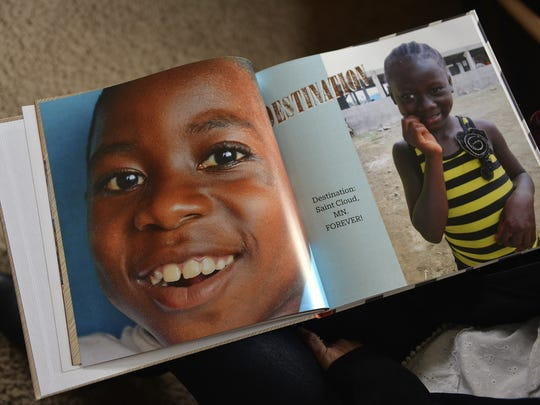 Emmanuel, a young boy in Liberia, wears a huge smile