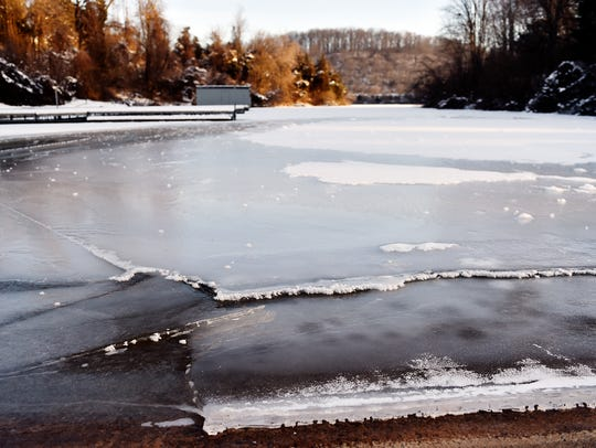 Ice is seen forming on the surface of Lake Redman at